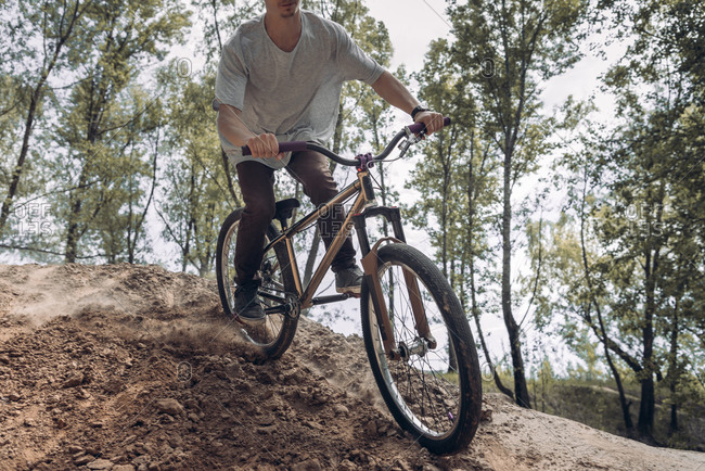 Cropped image of racer on mountain bike
