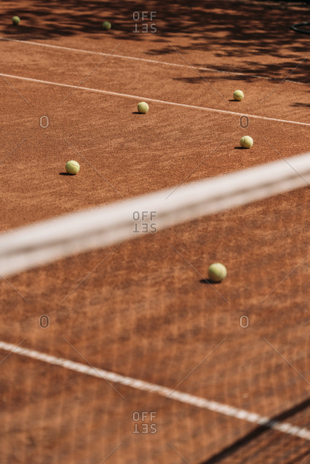 Tennis balls lying on court outdoors