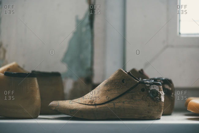Close-up view of unfinished footwear work pieces at shoemaker workshop