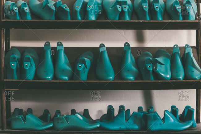 Rows of various shoe lasts on shelves