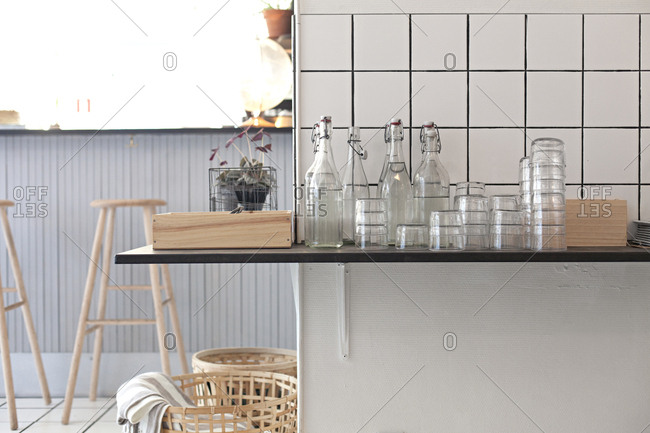 Detail of bottles and glasses on counter in cafe in Sweden