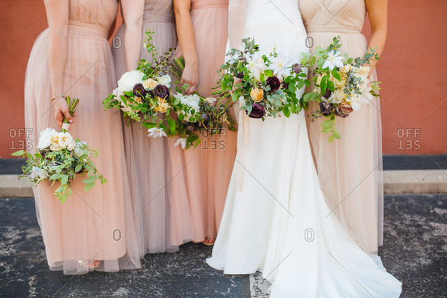Bride and her bridal party holding bouquets