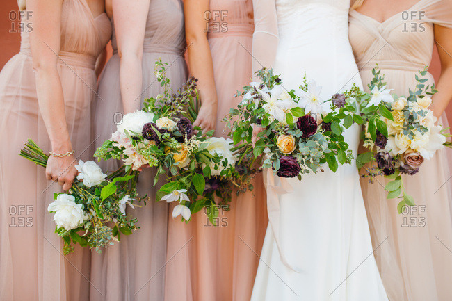 Bride and bridal party holding bouquets