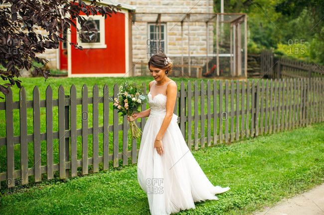 Bride walking with her bouquet