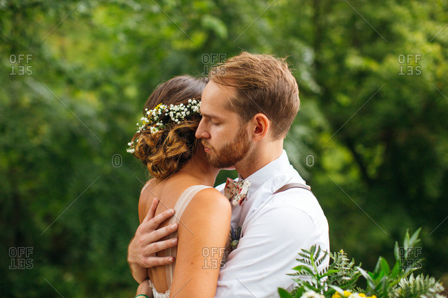 Bride and groom embraced on their wedding day