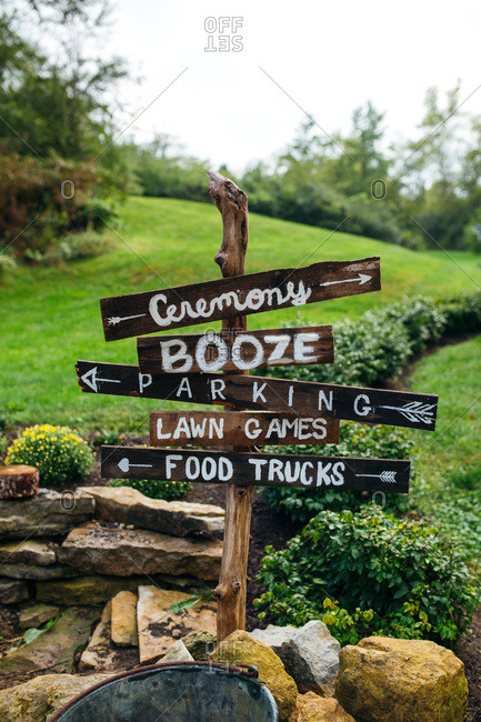 Directional signs at a wedding