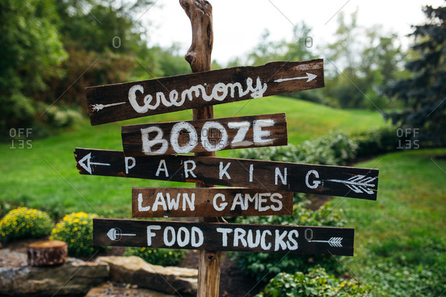 Close up of a rustic directional signs at a wedding