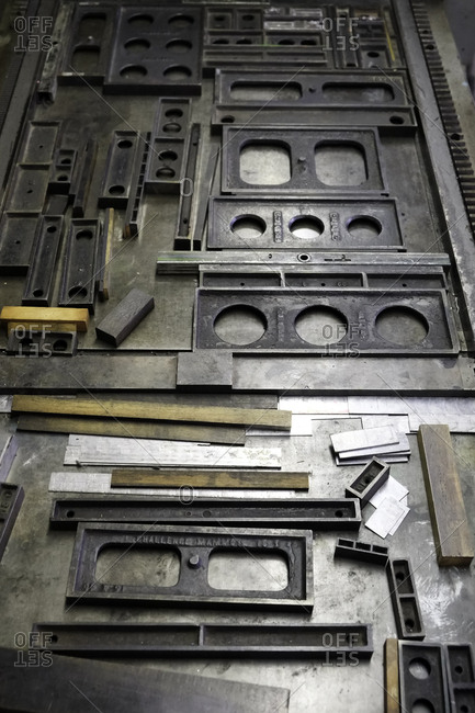 Overhead view of quoins, furniture and chases for an antique printing press