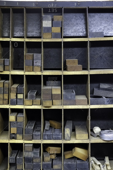 Furniture and blocks of various sizes stored in shelves in a printing shop