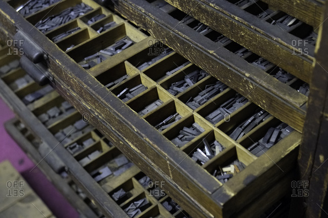 Close up of trays of letterpress letters in a cabinet in a printing shop