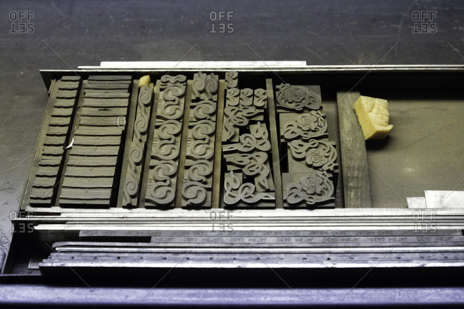 Overhead view of letterpress symbols in a tray in a printing shop