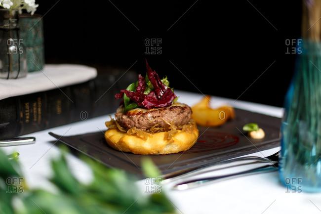 Gourmet open-faced hamburger