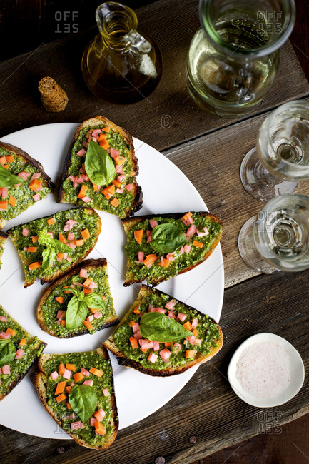 Kale asiago pesto crostini served with white wine