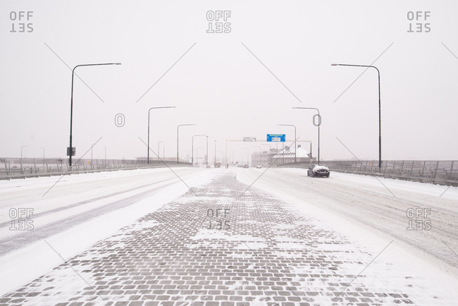 Cars driving along snowy highway in Malmo, Sweden
