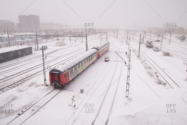 Malmo, Sweden - 28 February, 2018:  Railway carriages sitting in rail yard in falling snow