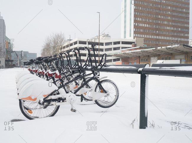 Malmo, Sweden - 28 February, 2018: Row of share bikes covered in snow