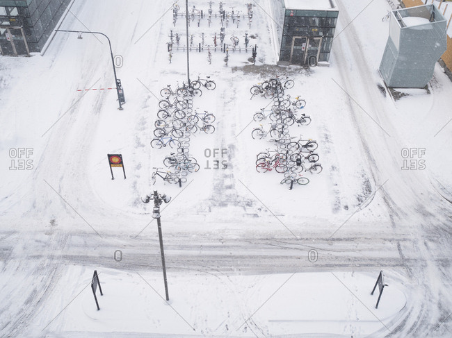 High angle view of bicycles in bike racks in the falling snow in Malmo, Sweden