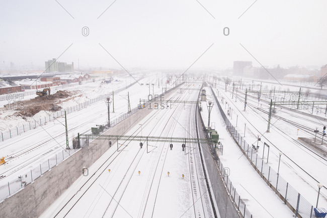 Looking along train tracks from high angle in the falling snow in Malmo, Sweden