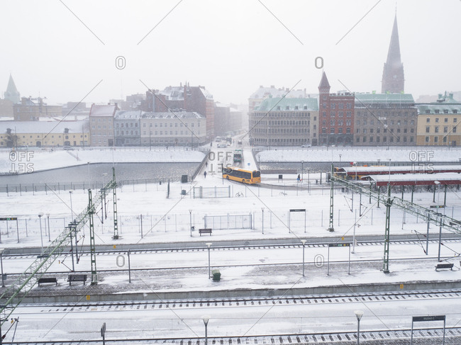 Malmo, Sweden - 28 February, 2018: Looking across train tracks and canal from high angle to cityscape