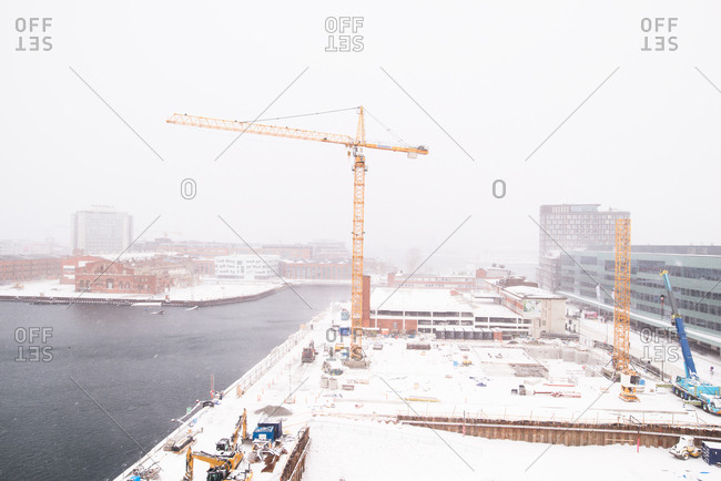 High angle view of construction on the waterfront in the falling snow in Malmo, Sweden