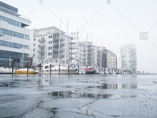 Low angle view of boats in marina in freezing conditions in Malmo, Sweden