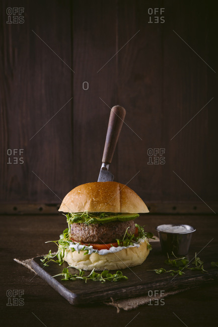 Lamb burger on cutting board