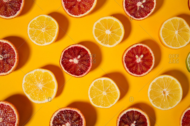 Patterned oranges and lemons on a bright yellow background