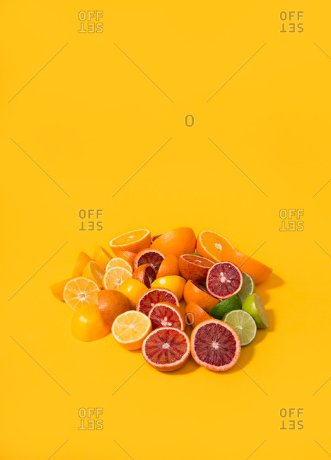 Citrus slices on a bright yellow background