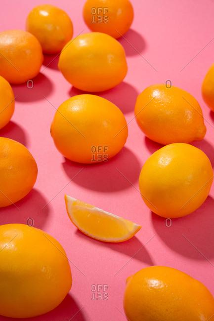 Oranges on a pink backdrop