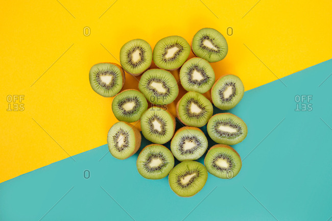 Kiwi halves on a geometric background