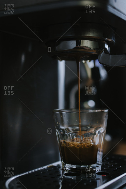 Dark moody photo of espresso being made