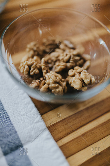 Glass bowl filled with walnuts