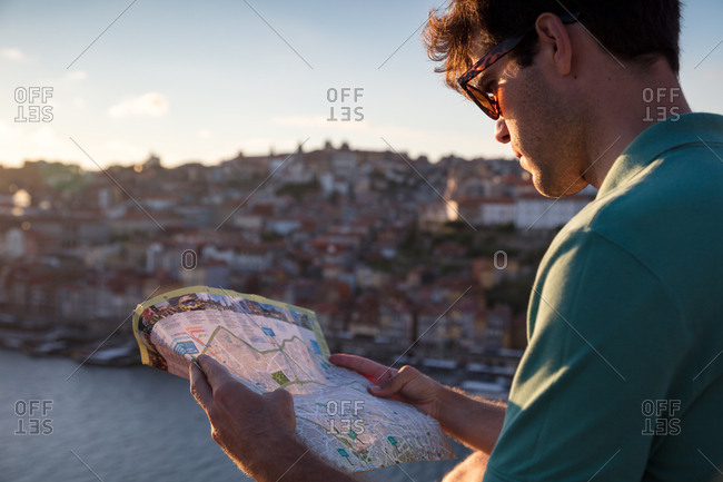 Porto, Portugal - July 27, 2017: Tourist reads map on bridge