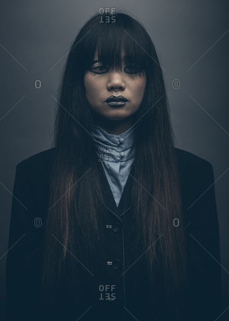 Moody fashion portrait of model with long hair