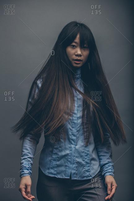 Model posing in studio with flowing waist length hair