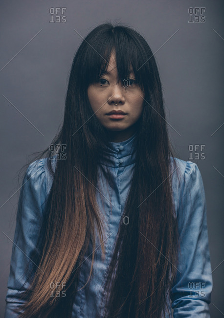 Moody fashion portrait of model in studio