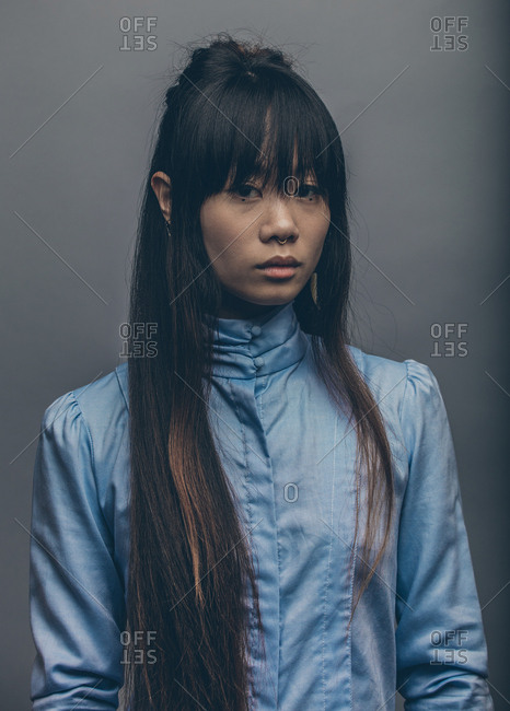 Low key fashion portrait of model with long hair up