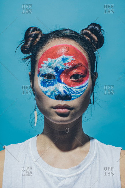 Portrait of model with wave painted on face