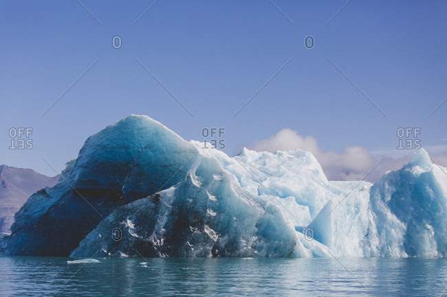 Close up of dark blue iceberg in Jokulsarlon glacier lagoon of south Iceland