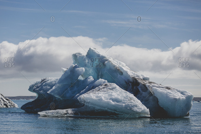 Large dark blue iceberg in Jokulsarlon glacier lagoon of south Iceland