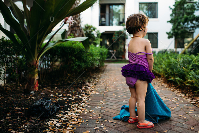 Stubborn little girl refusing to go any further after leaving hotel swimming pool