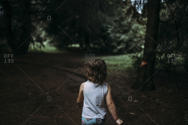 Girl walking in the forest, Hamilton, New Zealand