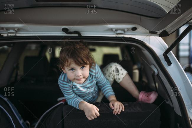 Girl climbing in car