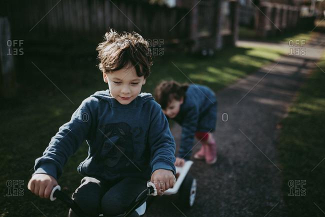 Boy and girl riding bike