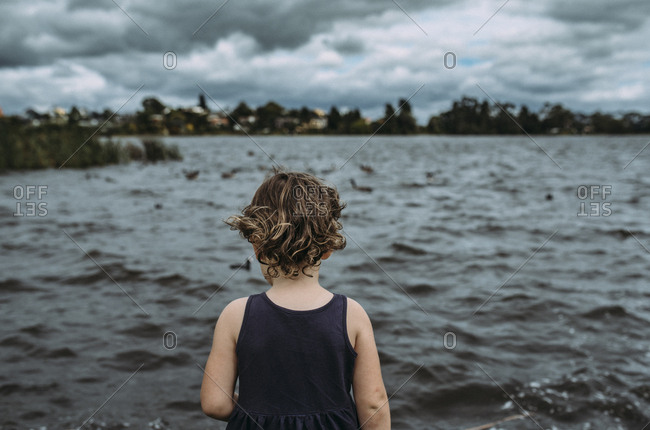 Girl standing near lake, Hamilton, New Zealand