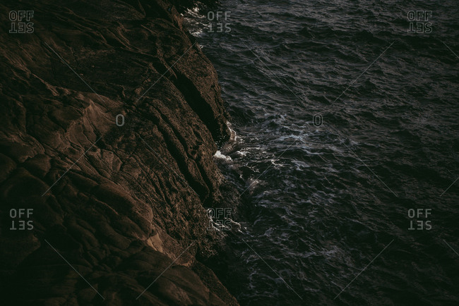Rocky cliffs of Muriwai Beach, Auckland, New Zealand