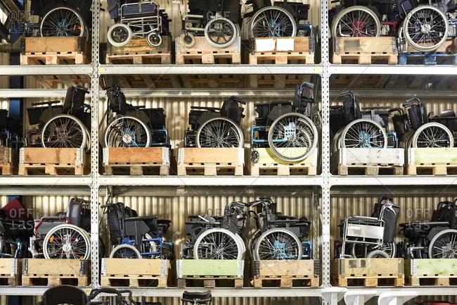 Full frame shot of wheelchairs on rack at warehouse