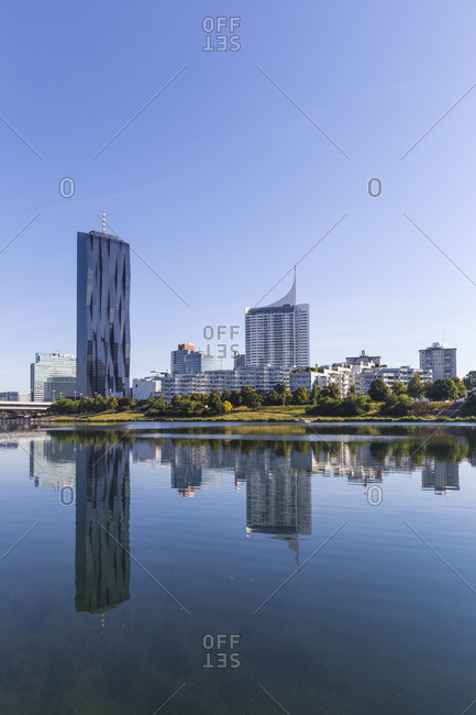 June 15, 2017: Austria, Vienna, Donau City reflecting in New Danube River
