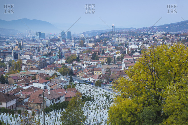 Bosnia and Herzegovina, Sarajevo, View over Kovaci War Memorial and Cemetery to the City