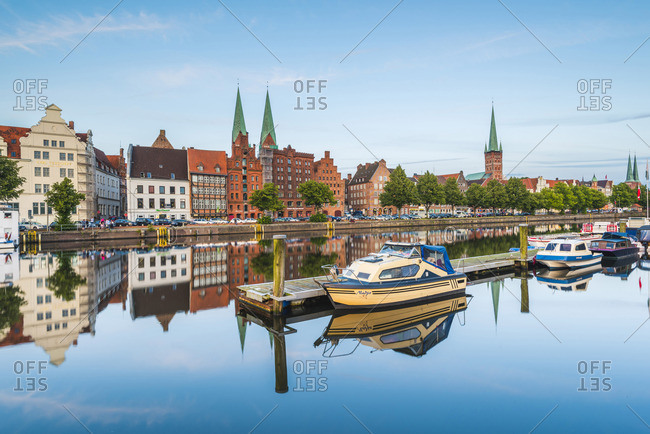 Lubeck - July 15, 2017: Lubeck, Baltic coast, Schleswig-Holstein, Germany. Old town's houses reflecting in the Trave river.